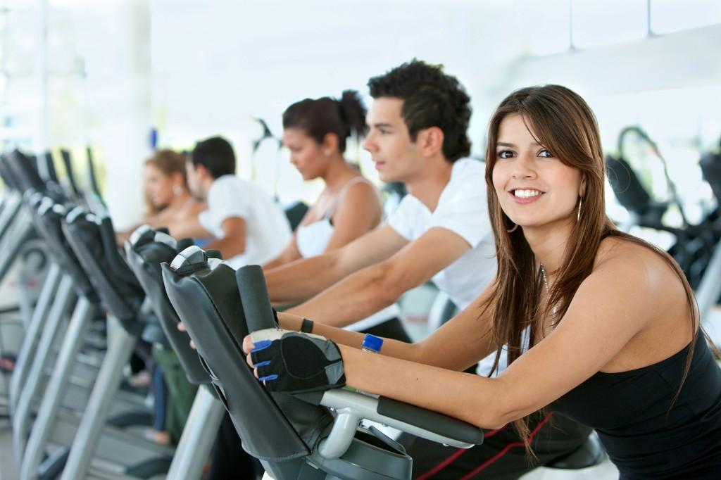 bigstock_Gym_People_On_Cardio_Machines_5898445